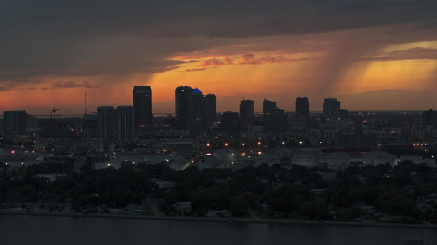 5.7K stock footage aerial video ascend while flying by the Downtown Tampa skyline at twilight, Florida Aerial Stock Footage | DX0003_232_004