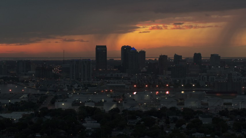 5.7K stock footage aerial video fly away from and past the Downtown Tampa skyline at twilight, Florida Aerial Stock Footage | DX0003_232_006