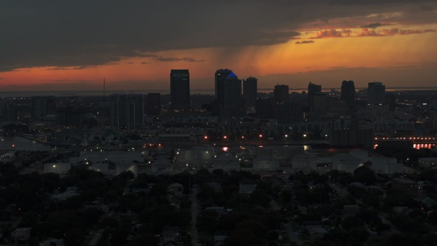 5.7K stock footage aerial video of passing the Downtown Tampa skyline at twilight, Florida Aerial Stock Footage | DX0003_232_008