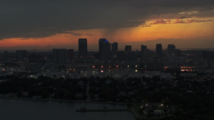 5.7K stock footage aerial video of slowly approaching the Downtown Tampa skyline at twilight, Florida Aerial Stock Footage | DX0003_232_010