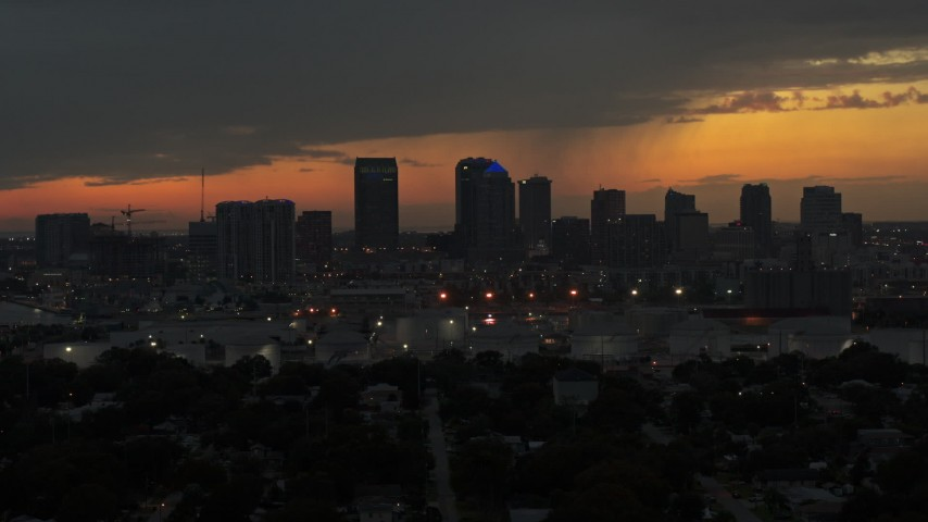 5.7K stock footage aerial video a reverse view of the Downtown Tampa skyline at twilight, Florida Aerial Stock Footage | DX0003_232_012