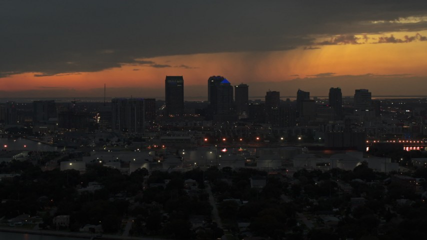 5.7K stock footage aerial video a stationary view of the Downtown Tampa skyline at twilight, Florida Aerial Stock Footage | DX0003_232_013