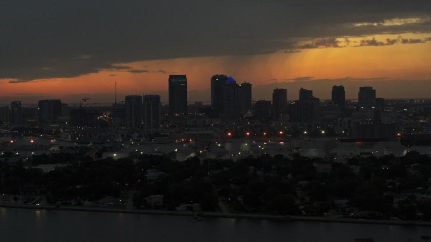 5.7K stock footage aerial video flying by skyscrapers in the Downtown Tampa skyline at twilight, Florida Aerial Stock Footage | DX0003_232_014