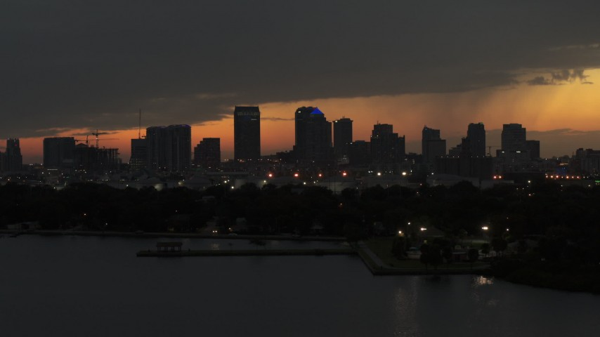 5.7K stock footage aerial video of passing skyscrapers in the Downtown Tampa skyline at twilight, Florida Aerial Stock Footage | DX0003_232_019