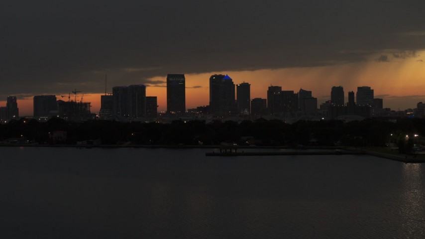 5.7K stock footage aerial video fly over bay with view of skyscrapers in the Downtown Tampa skyline at twilight, Florida Aerial Stock Footage | DX0003_232_021
