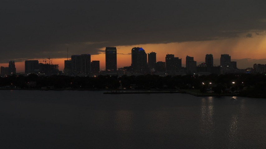 5.7K stock footage aerial video stationary view of skyscrapers in the Downtown Tampa skyline at twilight, Florida Aerial Stock Footage | DX0003_232_022