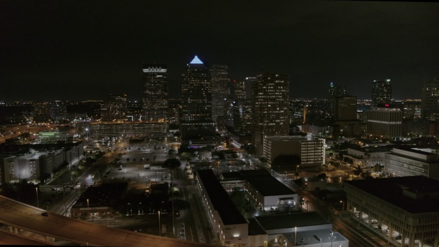 5.7K stock footage aerial video of circling skyscrapers at night in Downtown Tampa, Florida Aerial Stock Footage | DX0003_232_026