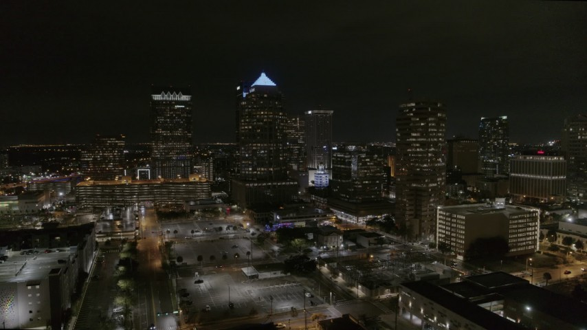 5.7K stock footage aerial video orbit and fly away from skyscrapers at night in Downtown Tampa, Florida Aerial Stock Footage | DX0003_232_027