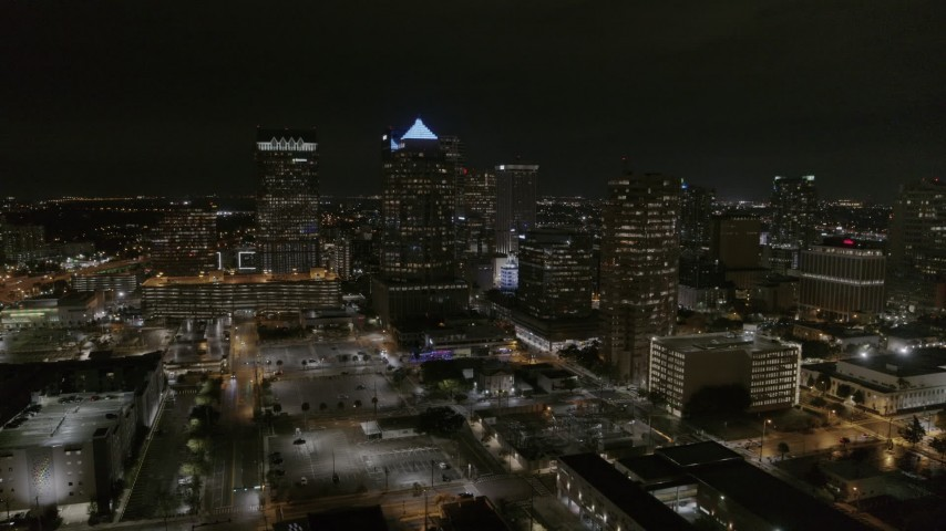 5.7K stock footage aerial video of a reverse view of skyscrapers at night in Downtown Tampa, Florida Aerial Stock Footage | DX0003_232_030