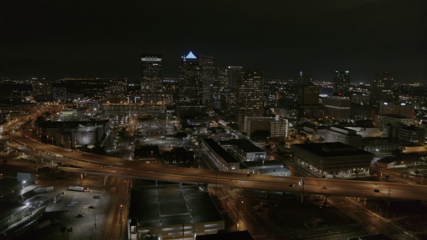 5.7K stock footage aerial video descend while focused on skyscrapers at night in Downtown Tampa, Florida Aerial Stock Footage | DX0003_232_031