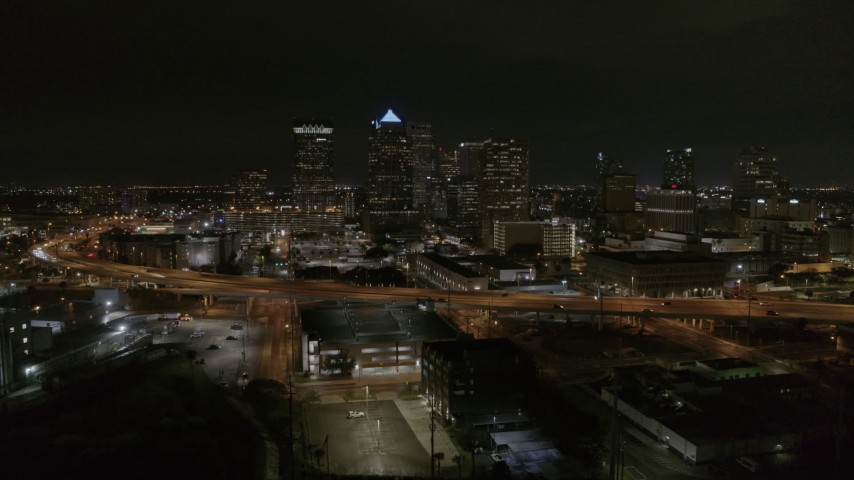 5.7K stock footage aerial video fly away from and orbit skyscrapers at night in Downtown Tampa, Florida Aerial Stock Footage | DX0003_232_033