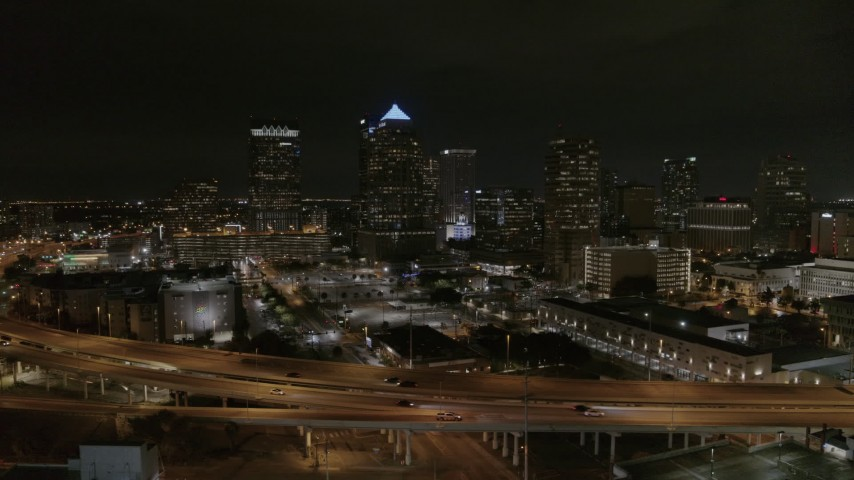5.7K stock footage aerial video of approaching skyscrapers at night in Downtown Tampa, Florida Aerial Stock Footage | DX0003_232_034
