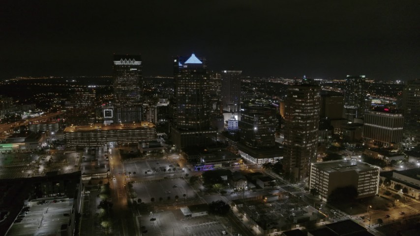 5.7K stock footage aerial video of slowly flying away from skyscrapers at nighttime in Downtown Tampa, Florida Aerial Stock Footage | DX0003_232_035
