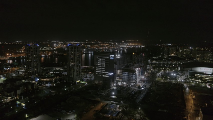 5.7K stock footage aerial video of orbiting medical college at nighttime in Downtown Tampa, Florida Aerial Stock Footage | DX0003_232_037