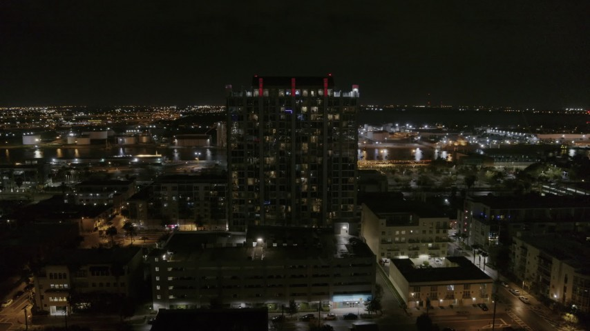 5.7K stock footage aerial video of circling an apartment building at night in Downtown Tampa, Florida Aerial Stock Footage | DX0003_232_039
