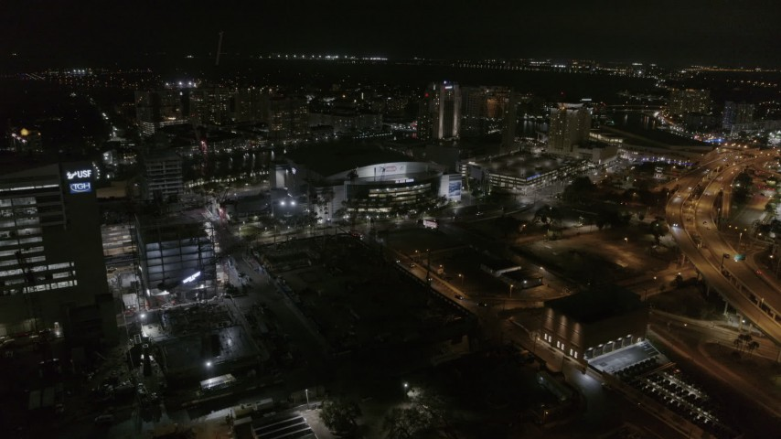 5.7K stock footage aerial video of slowly approaching Amalie Arena at night in Downtown Tampa, Florida Aerial Stock Footage | DX0003_232_044