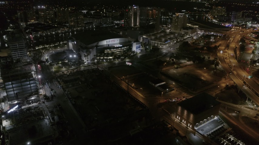 5.7K stock footage aerial video of slowly flying away from Amalie Arena at night in Downtown Tampa, Florida Aerial Stock Footage | DX0003_232_045
