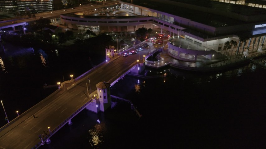 5.7K stock footage aerial video of police cars on the bridge by convention center at night in Downtown Tampa, Florida Aerial Stock Footage | DX0003_232_047