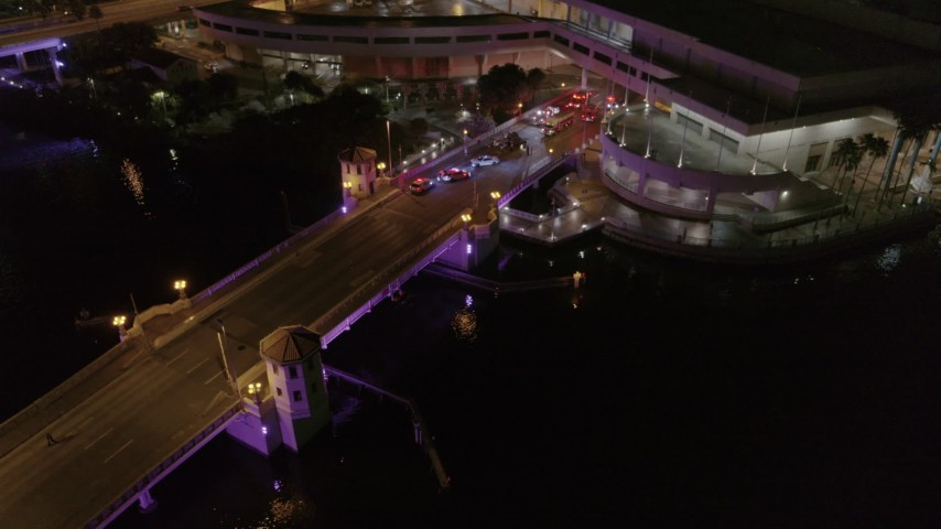 5.7K stock footage aerial video orbit and fly away from police cars on the bridge by convention center at night in Downtown Tampa, Florida Aerial Stock Footage | DX0003_232_048