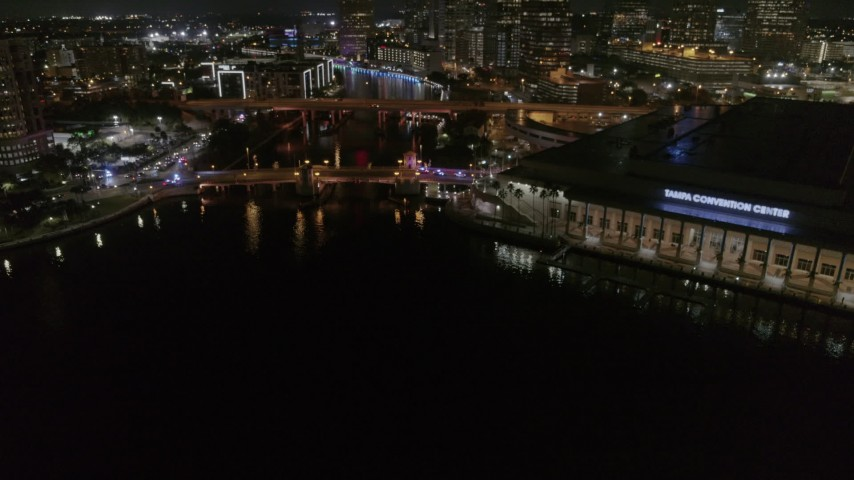 5.7K stock footage aerial video orbit police cars on the bridge by convention center at night in Downtown Tampa, Florida Aerial Stock Footage | DX0003_232_049