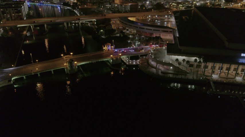 5.7K stock footage aerial video approach police cars on the bridge by convention center at night in Downtown Tampa, Florida Aerial Stock Footage | DX0003_232_050