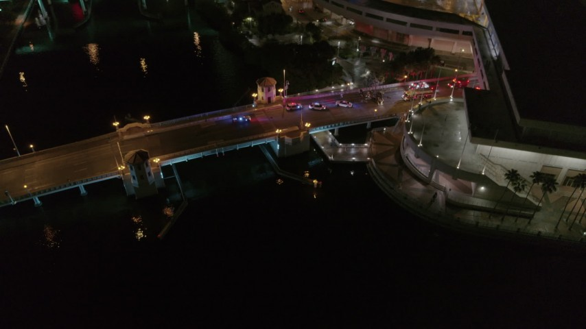 5.7K stock footage aerial video circle and fly away from police cars on the bridge by convention center at night in Downtown Tampa, Florida Aerial Stock Footage | DX0003_232_051