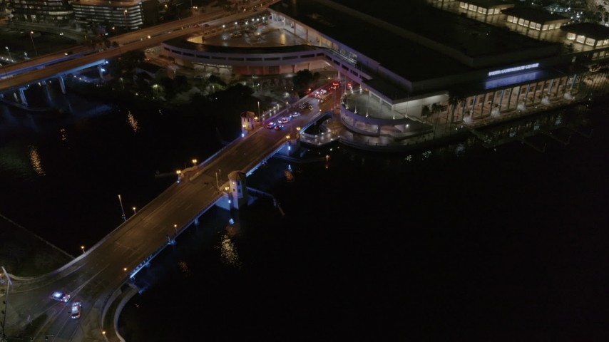 5.7K stock footage aerial video police cars on the bridge by convention center at night in Downtown Tampa, Florida Aerial Stock Footage | DX0003_232_052