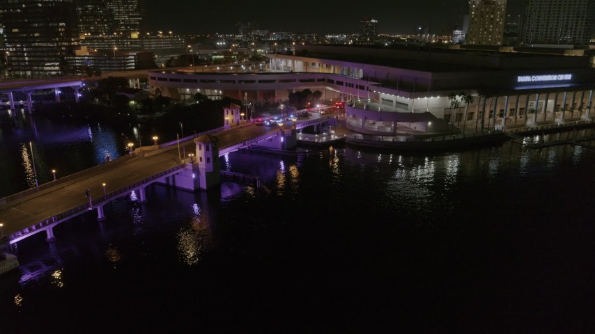 5.7K stock footage aerial video orbit police cars on a bridge by convention center at night in Downtown Tampa, Florida Aerial Stock Footage | DX0003_232_054