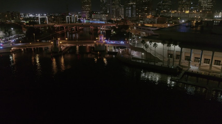 5.7K stock footage aerial video fly away from police cars on a bridge by convention center at night in Downtown Tampa, Florida Aerial Stock Footage | DX0003_232_055