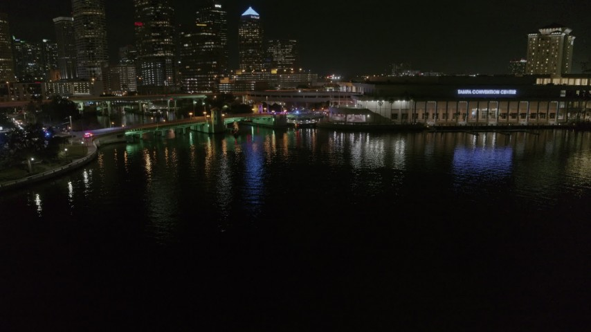 5.7K stock footage aerial video descend while focused on police cars on a bridge by convention center at night in Downtown Tampa, Florida Aerial Stock Footage | DX0003_232_056
