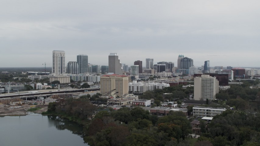 5.7K stock footage aerial video of ascending toward the city's skyline, Downtown Orlando, Florida Aerial Stock Footage | DX0003_233_001