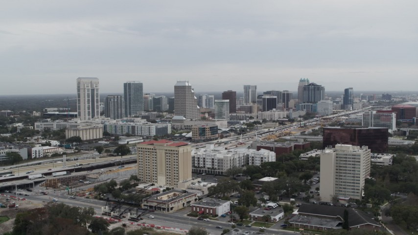 5.7K stock footage aerial video of a reverse view of the city's skyline, Downtown Orlando, Florida Aerial Stock Footage   DX0003_233_002