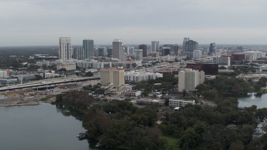 5.7K stock footage aerial video of the city's skyline seen from Lake Concord, Downtown Orlando, Florida Aerial Stock Footage   DX0003_233_008