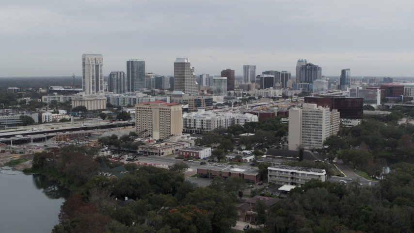 5.7K stock footage aerial video of flying toward hotel and the city's skyline, Downtown Orlando, Florida Aerial Stock Footage | DX0003_233_009