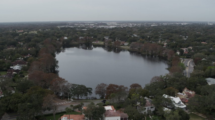 5.7K stock footage aerial video of a reverse view of waterfront homes around Lake Adair, Orlando, Florida Aerial Stock Footage | DX0003_233_011