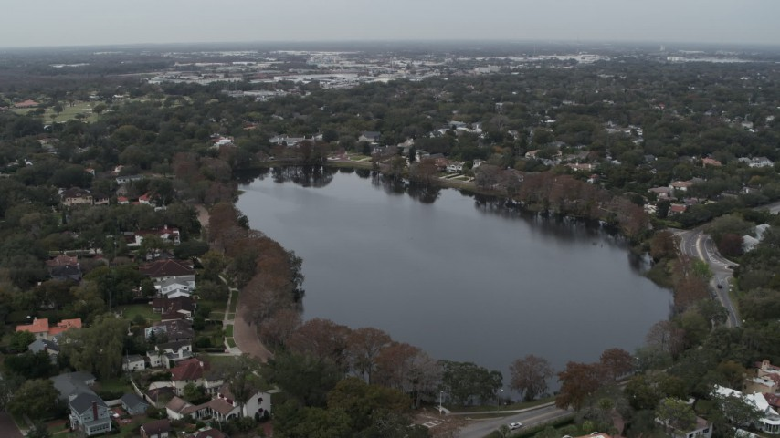 5.7K stock footage aerial video ascend away from waterfront homes around Lake Adair, Orlando, Florida Aerial Stock Footage   DX0003_233_013