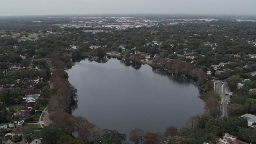 5.7K stock footage aerial video of flying by waterfront homes around Lake Adair, Orlando, Florida Aerial Stock Footage | DX0003_233_014