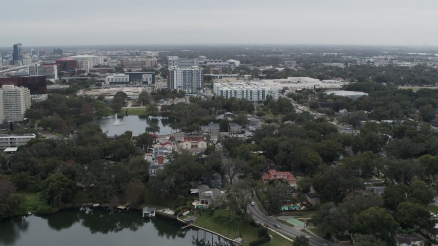 5.7K stock footage aerial video of flying away from Lake Dot and apartment buildings in Orlando, Florida Aerial Stock Footage | DX0003_233_019