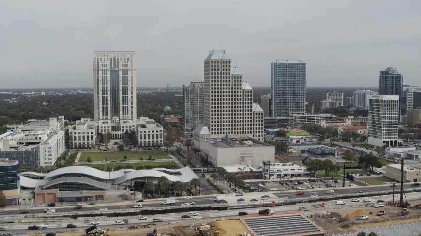 5.7K stock footage aerial video slowly fly away from Bank of America Center in Downtown Orlando, Florida Aerial Stock Footage | DX0003_233_037