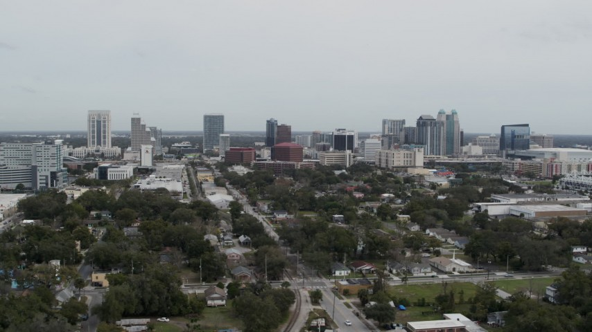 5.7K stock footage aerial video of slowly flying by the city's skyline, Downtown Orlando, Florida Aerial Stock Footage   DX0003_233_046