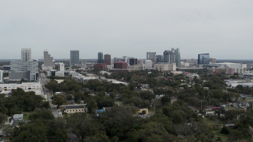 5.7K stock footage aerial video ascending past the city's skyline, Downtown Orlando, Florida Aerial Stock Footage | DX0003_233_049