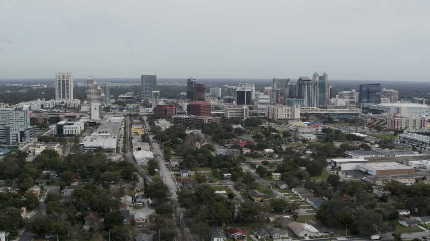 5.7K stock footage aerial video of passing the city's skyline, Downtown Orlando, Florida Aerial Stock Footage | DX0003_233_051