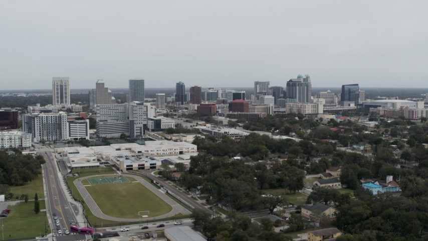 5.7K stock footage aerial video of passing by the skyline of Downtown Orlando, Florida Aerial Stock Footage | DX0003_233_053