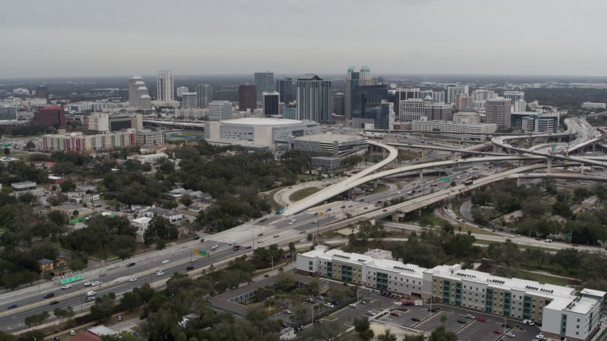 5.7K stock footage aerial video of Amway Center, city skyline beside freeway interchange, Downtown Orlando, Florida Aerial Stock Footage | DX0003_234_003