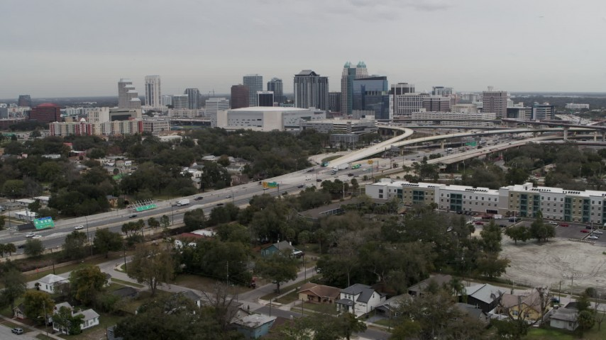 5.7K stock footage aerial video a view of Amway Center, city skyline, freeway interchange, Downtown Orlando, Florida Aerial Stock Footage | DX0003_234_007