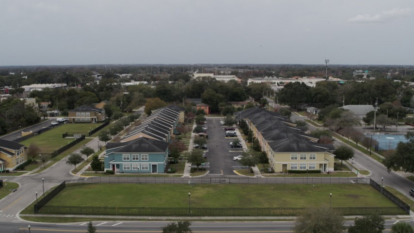 5.7K stock footage aerial video ascend away from an apartment complex in Orlando, Florida Aerial Stock Footage | DX0003_234_011