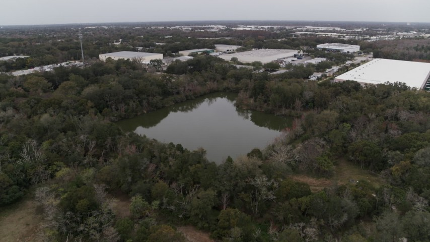 5.7K stock footage aerial video approach small lake and forest trees, Orlando, Florida Aerial Stock Footage | DX0003_234_055