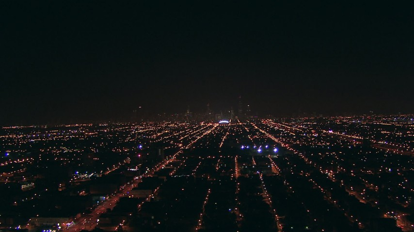 HD stock footage aerial video approach the Downtown Chicago, Illinois skyline from West Side suburbs at night Aerial Stock Footage | ED0001_000002
