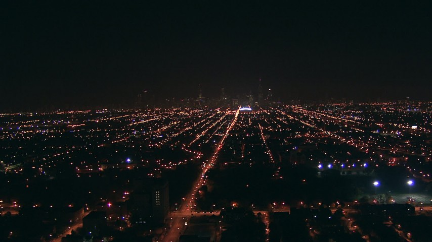 HD stock footage aerial video fly over West Side suburbs to approach Downtown Chicago, Illinois skyline at night Aerial Stock Footage | ED0001_000003