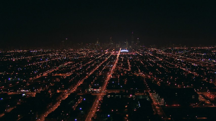 HD stock footage aerial video fly over the West Side to approach Downtown Chicago, Illinois skyline at night Aerial Stock Footage | ED0001_000004